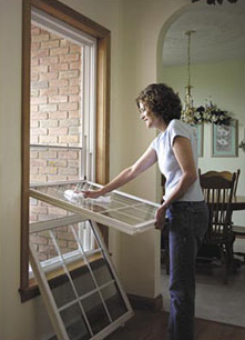 Woman Cleaning Double Hung Window
